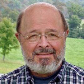 Dennis Avery Headshot