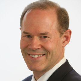 John D. Macomber Headshot
